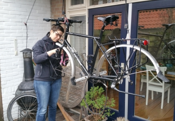 Anneke cleaning her bike